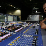 This image shows Schon Emmanuel in studio on his mixing console